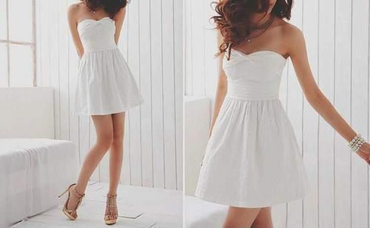 beyaz elbise giymiş kadın görmek