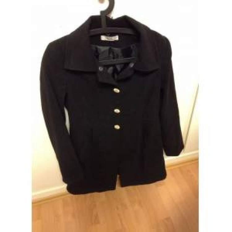 Rüyada Siyah Palto Giymek