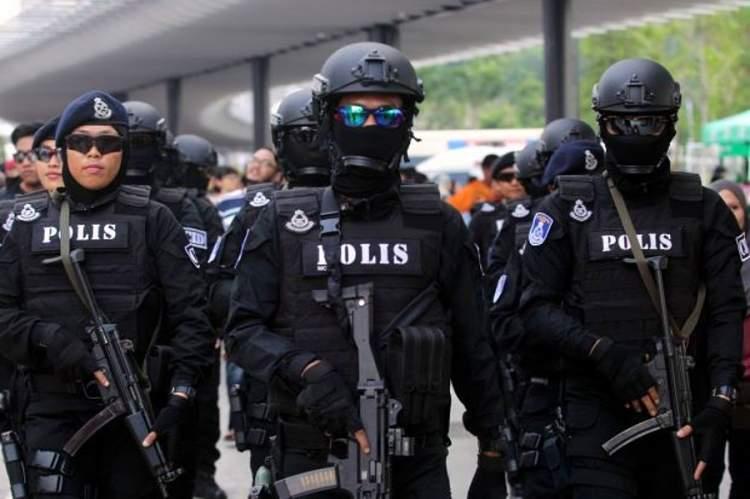 polis ve silah görmek